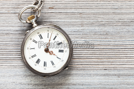 vintage pocket watch on gray wooden