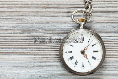 retro pocket watch on gray wooden