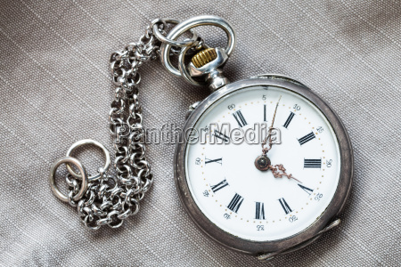 pocket watch with chain on textile