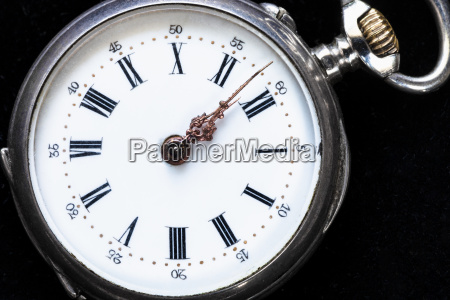 vintage pocket watch on black velvet