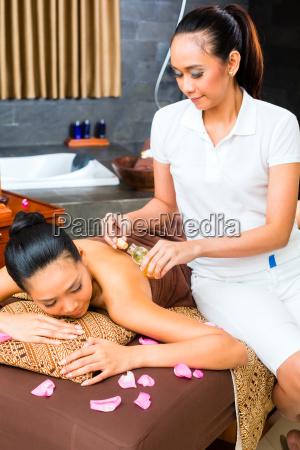 beautiful asian woman receiving massage