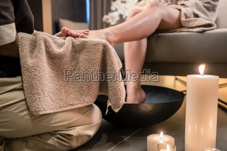 asian therapist wiping the feet of