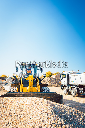 construction workers doing earthworks with wheel