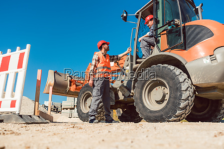 construction worker starting road works on