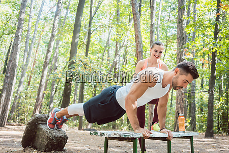 sporty man doing push up in