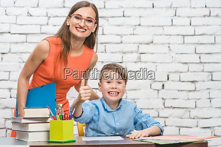 pupil and teacher having fun at
