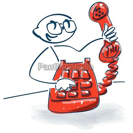 stick figure con un vecchio telefono