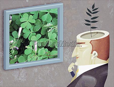 uomo con la pianta che cresce