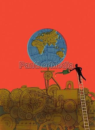 man oiling turning globe