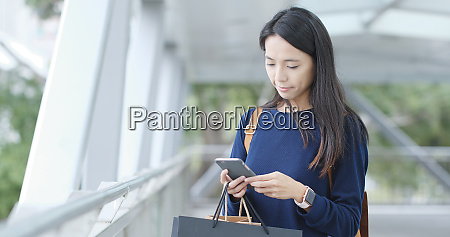 woman look at mobile phone with