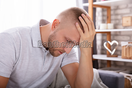 upset man sitting on sofa