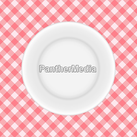 white plate on a checkered tablecloth