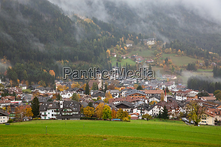 village in fog in late autumn