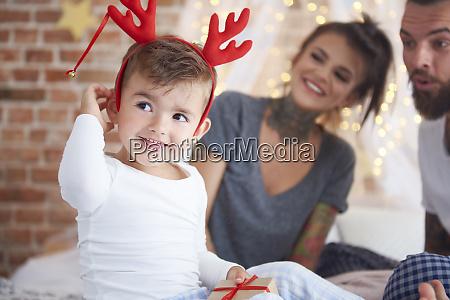 cute boy in reindeer costume at