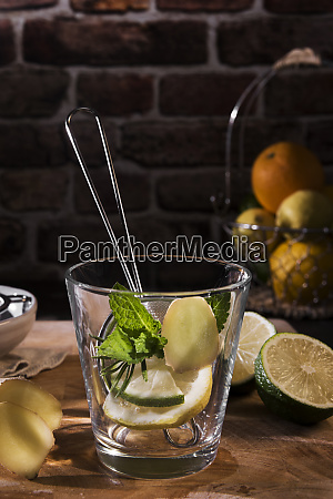 preparing detox water with mint rosmary