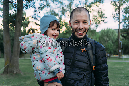 portrait of father and little daughter