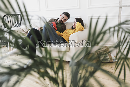 couple sitting on the couch in