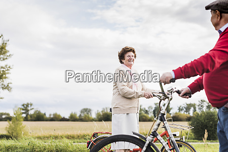 senior man and woman with bicycles