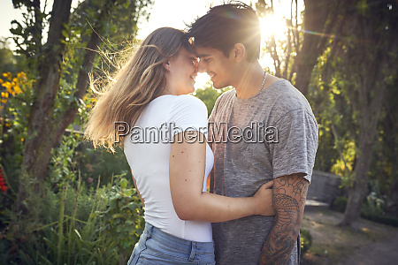 happy young couple embracing and kissing