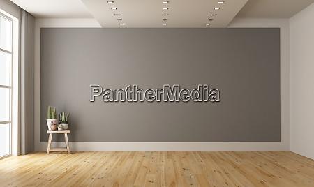 camera minimalista vuota con parete grigia