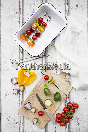 vegetarian grill spits orange and yellow