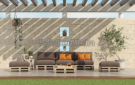 garden with pallet sofa with stone