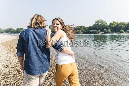 happy young couple in love walking