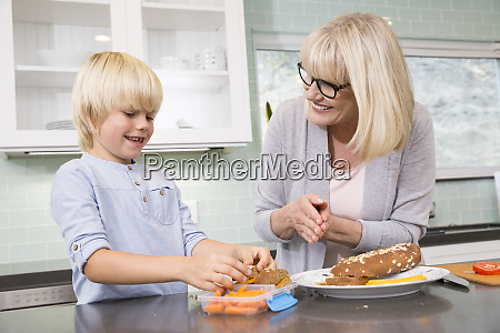 grandmother and grandson preparing lunch box