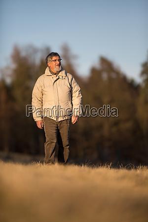 portrait of a senior man walking