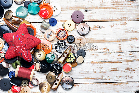 various sewing buttons and thread