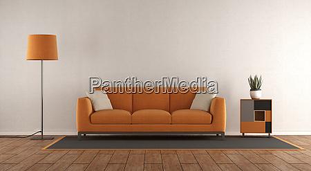 minimalist white and orange living room
