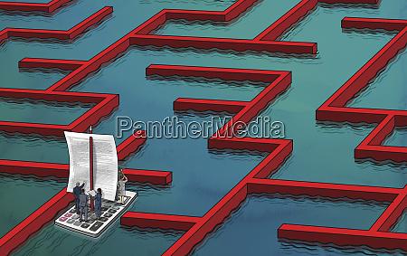 uomini daffari che navigano nel labirinto