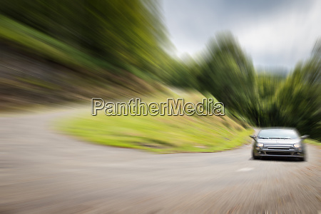 blurred view of car driving on