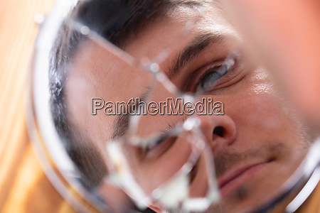 reflection of a mans face in