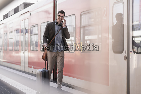 smiling young man on cell phone