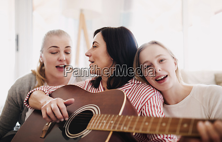 mature woman with two daughters singing