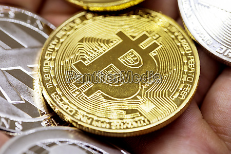 golden bitcoin in a man hand