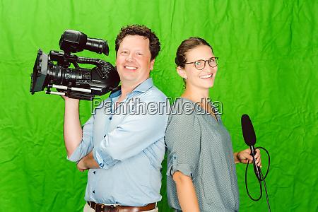 crew of reporter and cameraman posing