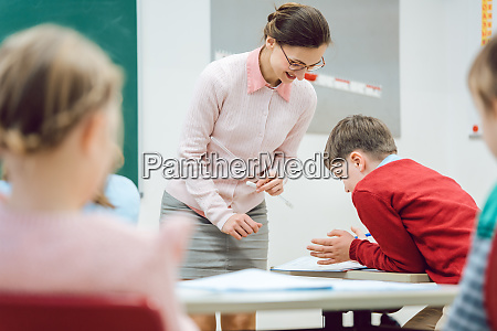 teacher woman talking to student in
