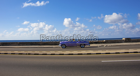 havana cuba a shiny purple convertible