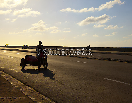 havana cuba silhouetted person traveling along