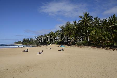 sunbathers at haena state park kee