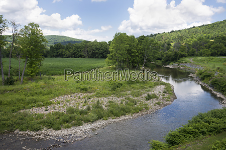 ottauquechee river flowing through green countryside