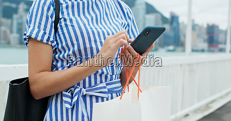 woman use of mobile phone with