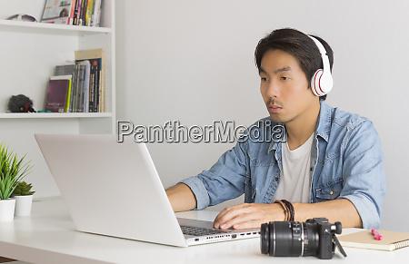 asian freelance videographer checking multimedia sound