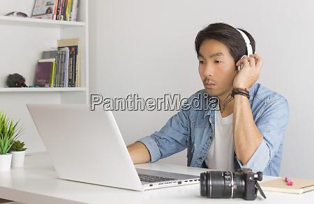 asian freelance videographer testing multimedia sound