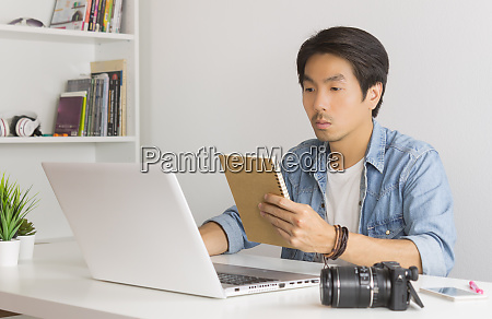 asian photographer or freelancer checking work