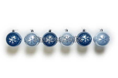 electric blue christmas balls isolated on