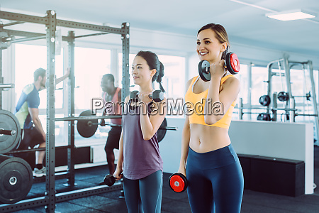 two women doing fitness training together