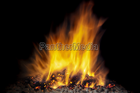 burning wood pellets visible flame and